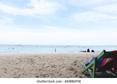 chair on beach. Beach chair on sea coast.