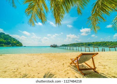 Chair on the Beautiful tropical beach and sea with coconut palm tree in paradise island for travel and vacation