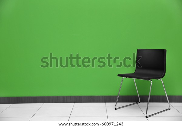 Chair on color wall background