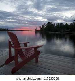 Chair on the dock at sunset in Lake of the Woods, Ontario