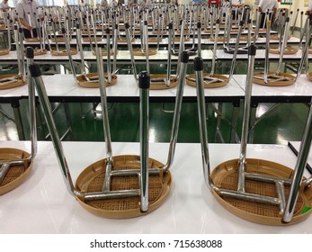 A lot of chair on table in canteen of factory on break time.