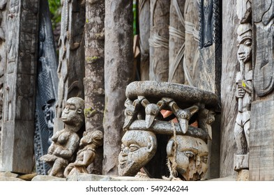 Chair and other African wood carvings at traditional Fon's palace in Bafut, Cameroon, Africa