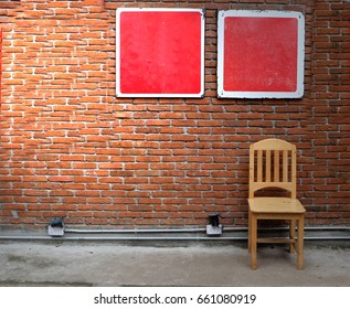 Chair with red brick wall
