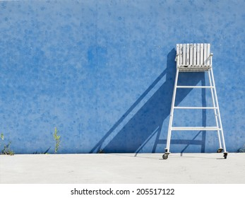 chair referee on blue wall