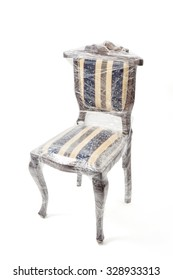 Chair in retro style wrapped up in a transparent foil  and is ready for transport. The image contains a clipping path.