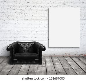 chair in room and blank poster on wall