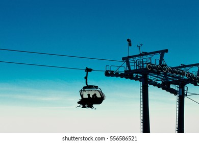 Chair ski lifts in ski resort going up