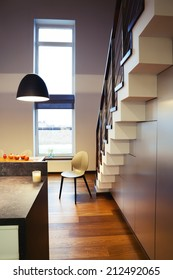 Chair and staircase in modern house interior