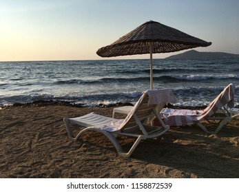 chair and sunset by the sea