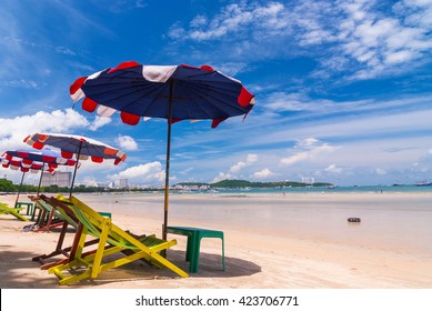 Chair and umbrella on beautiful Pattaya beach , In year 2007, signs Pattaya city  are public.