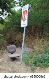 Chair under locality marking and road sign, Podkerepušky, Bratislava, Slovakia
