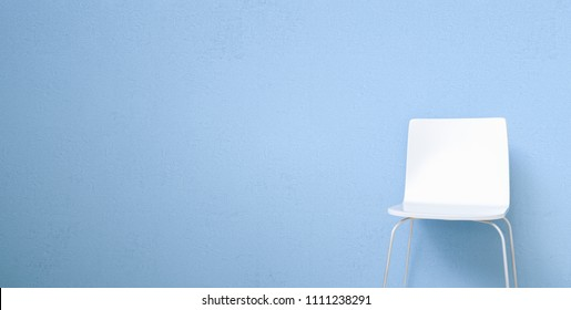 chair in a waiting room of a doctor's office in front of a blue wall, with copy space for individual text