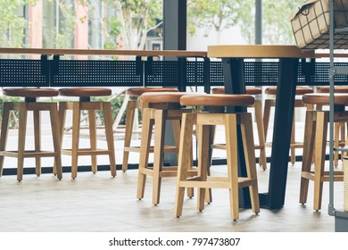 the chair and wooden table in the cafe