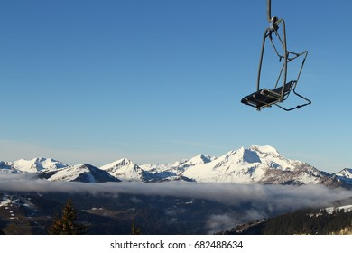 Chairlift over the clouds