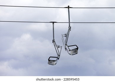 Chair-lift and overcast sky. Caucasus Mountains, Georgia, ski resort Gudauri.