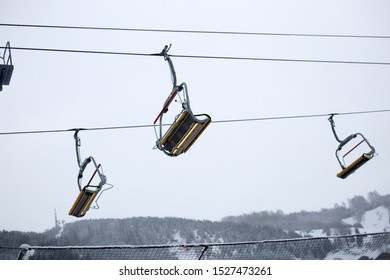 chairlift, a series of chairs hung from a moving cable, typically used for carrying passengers up and down a mountain