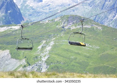 Chairlifts with Alpine Mountain Scenery