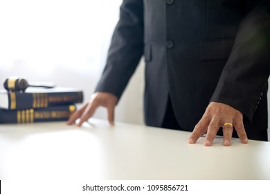 chairman or head of justice  lawer stand at the table with balance and gavel