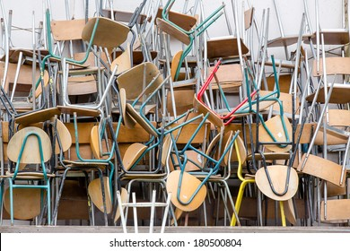 a lot of chairs arranged in a pile