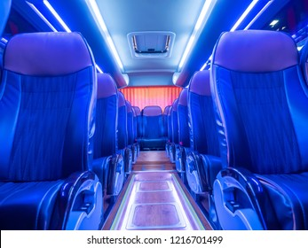 Chairs in the bus. Passenger transport. Sightseeing bus. Travel by bus. Rows of passenger seats.