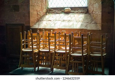 Chairs in a church of Collonges-la-Rouge, Limousin, France