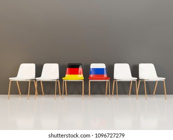 Chairs with flag of Germany and russia in a row. 3D illustration
