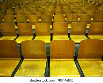 Chairs are lined up in a conference room
