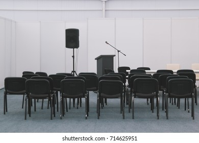A lot of chairs in meeting or conferences room
