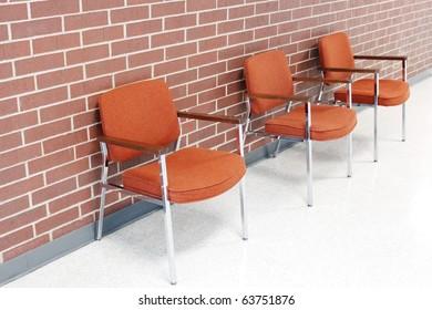 Chairs near a wall
