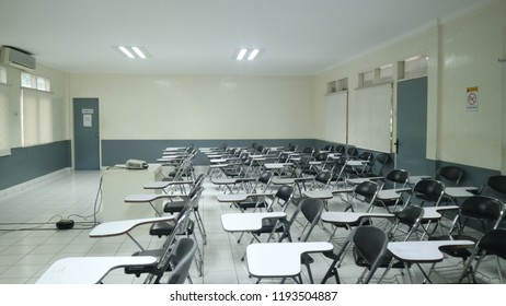 the chairs are neatly arranged in the classroom