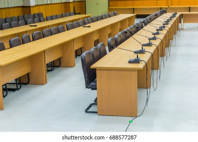 The chairs are neatly arranged in the conference room