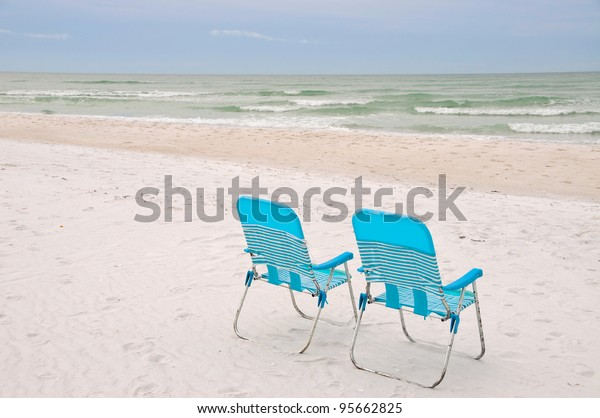 chairs-on-beach-600w-95662825.jpg