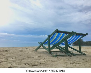 Chairs on the beach with blue sky