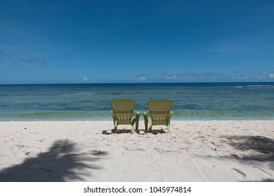 Chairs on the beautiful seaside under the blue sky in Guam