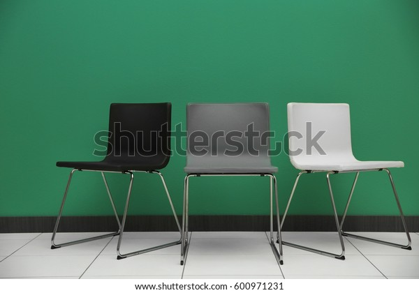 Chairs on color wall background