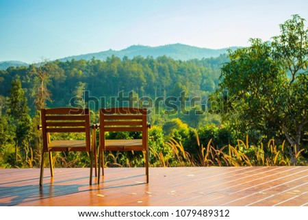 Chairs On Fenceless Balcony Mountain View Stock Photo Edit Now