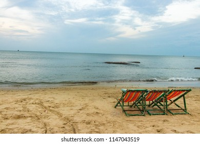 Chairs on the sandy beach near the sea with wave . Summer holiday and vacation concept.