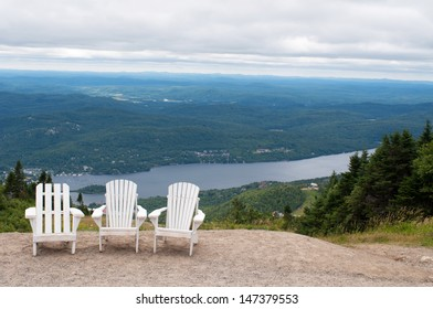 Chairs on top of mountain  at a ski resort during summer time depicting relaxing concept