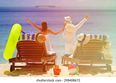 chairs on tropical beach, family vacation concept