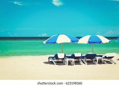 chairs on tropical sand beach