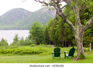 chairs overlooking Jordan Pond and the Bubble Mountains