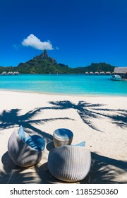 Chairs and palm tree shadows in Bora Bora, Tahiti