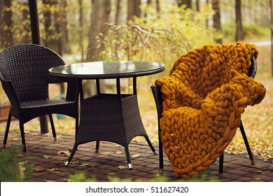 chairs in park cafe with a warm merino wool plaid
