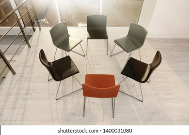 Chairs prepared for group therapy session in office. Meeting room interior
