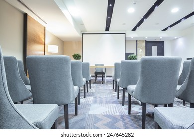 Chairs in a row in conference room