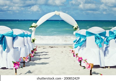 Chairs set up for beach wedding
