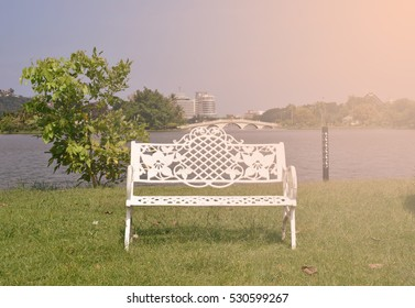 Chairs set on the lawn in the park. /Warm colors