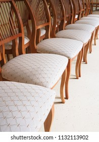 Chairs with soft seats are in a row.