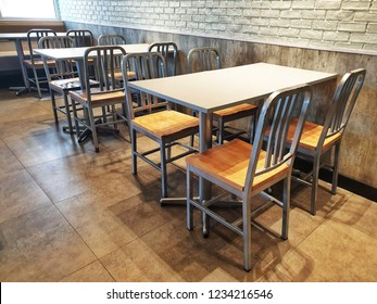 Chairs and table in the empty restaurant.