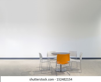 chairs and a table in front of a white wall with space to paste your own images